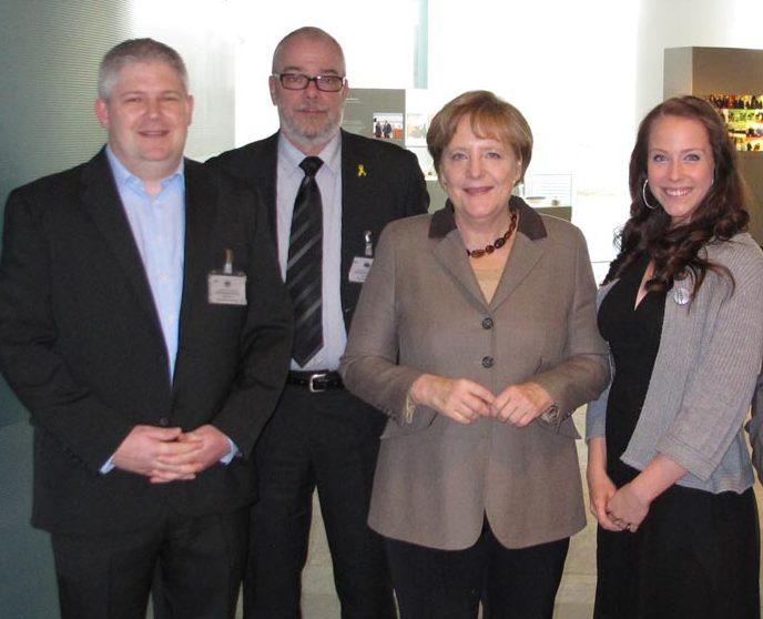 Thomas Blaeschke (Voice Over Piano), Henning Klausing (EAS), Federal Chancellor Dr. Angela Merkel and Sara Dähn - Berlin